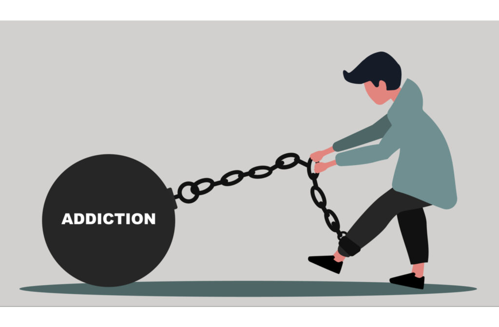 """Guy chained up to ball with words """"Addiction"""" written on it on grey background."""