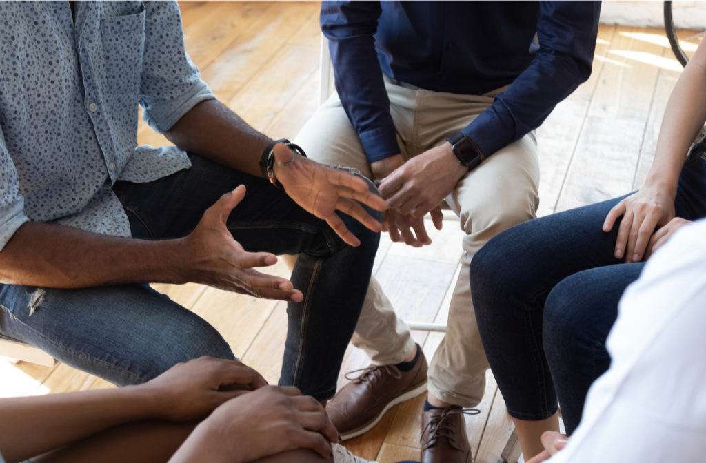 support group together discussing issues about mental illness.